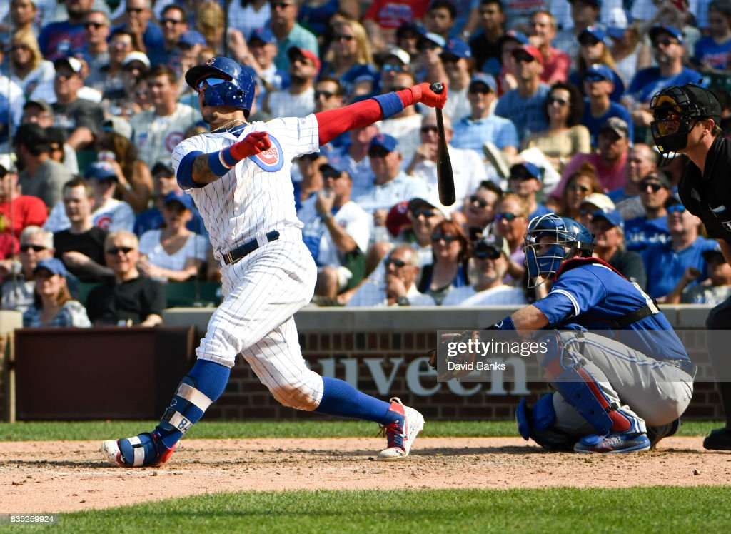 Javier Baez #9 of the Chicago Cubs hits a two-run homer against the Toronto Blue Jays during the eighth inning on August 18, 2017 at Wrigley Field in Chicago, Illinois.