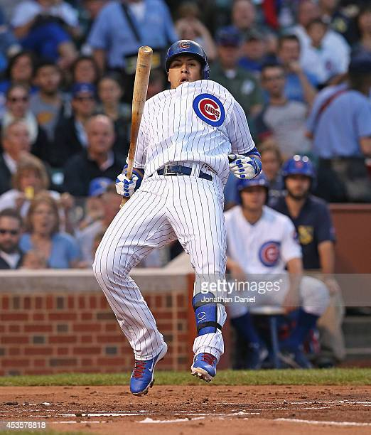 Javier Baez of the Chicago Cubs hops out of the way of an inside pitch against the Milwaukee Brewers at Wrigley Field on August 13 2014 in Chicago...