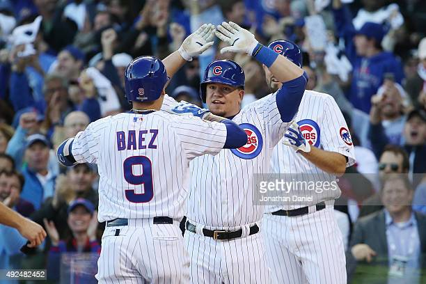 Javier Baez of the Chicago Cubs is congratulated by Kyle Schwarber of the Chicago Cubs after hitting a threerun home run in the second inning against...