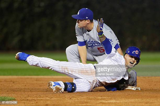 Javier Baez of the Chicago Cubs is safe at second base after hitting an RBI double to score Jason Heyward in the second inning against the Los...