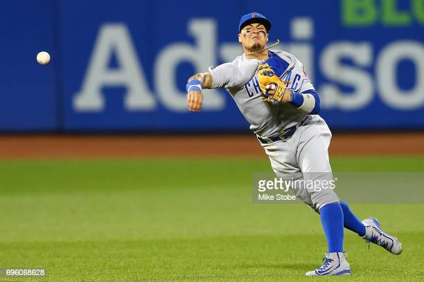 Javier Baez of the Chicago Cubs is unable to throw out TJ Rivera of the New York Mets for an infield single in the fifth inning at Citi Field on June...