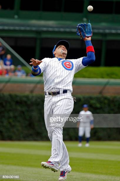 Javier Baez of the Chicago Cubs makes a catch for an out against the Washington Nationals during the first inning at Wrigley Field on August 4 2017...
