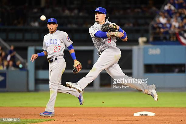 Javier Baez of the Chicago Cubs makes a throw to first in the seventh inning against the Los Angeles Dodgers in game five of the National League...