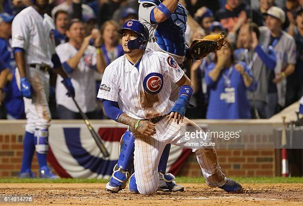 Javier Baez of the Chicago Cubs reacts after stealing home in the second inning against the Los Angeles Dodgers during game one of the National...