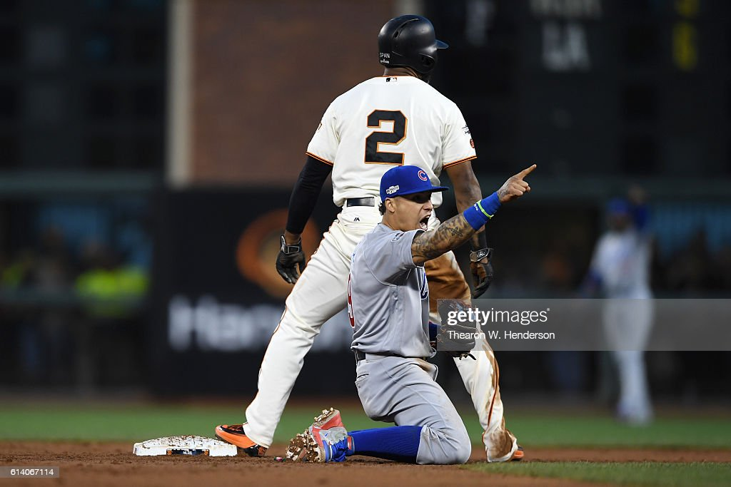 Javier Baez #9 of the Chicago Cubs reacts after tagging out Denard Span #2 of the San Francisco Giants attempting to steal second base in the third inning of Game Four of their National League Division Series at AT&T Park on October 11, 2016 in San Francisco, California.