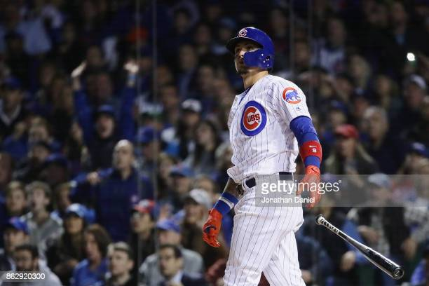 Javier Baez of the Chicago Cubs reacts to hitting a home run in the second inning against the Los Angeles Dodgers during game four of the National...
