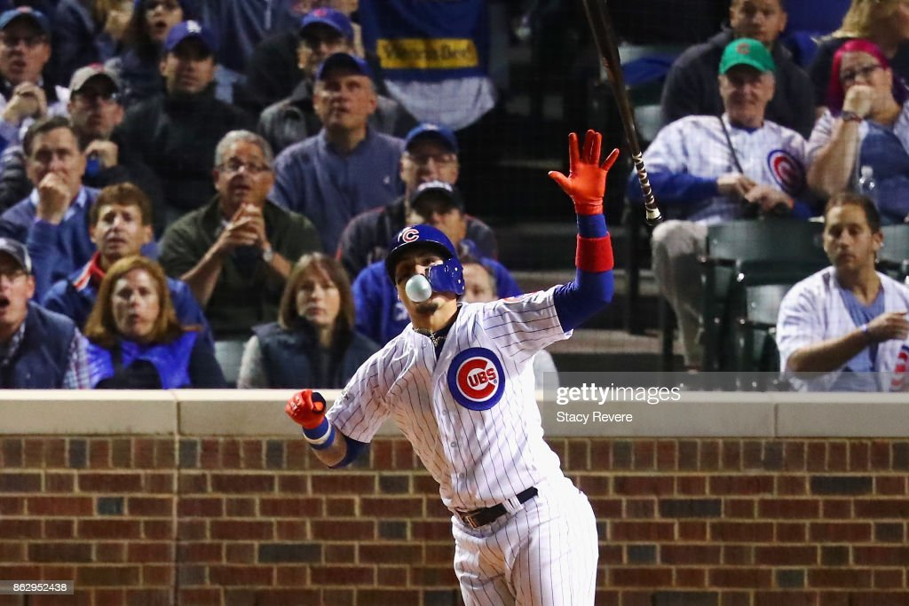 Javier Baez #9 of the Chicago Cubs reacts to hitting a home run in the fifth inning against the Los Angeles Dodgers during game four of the National League Championship Series at Wrigley Field on October 18, 2017 in Chicago, Illinois.