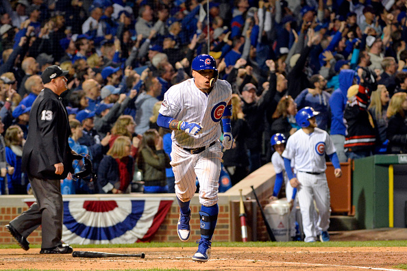 Javier Baez of the Chicago Cubs rounds the bases after hitting a solo home run in the eighth inning during Game 1 of NLDS against the San Francisco...