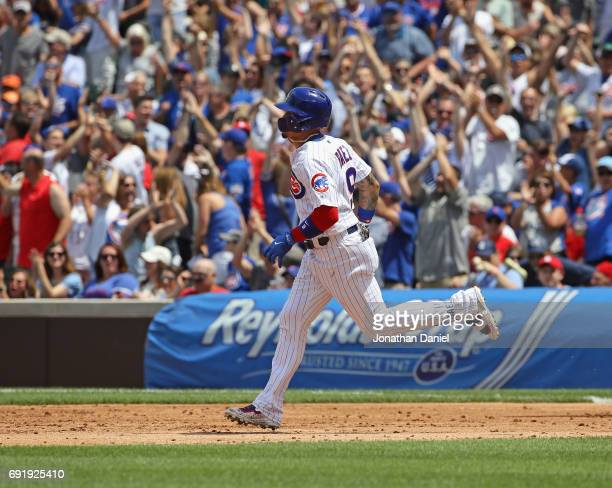 Javier Baez of the Chicago Cubs runs the bases after hitting a solo home run in the 3rd inning against the St Louis Cardinals at Wrigley Field on...