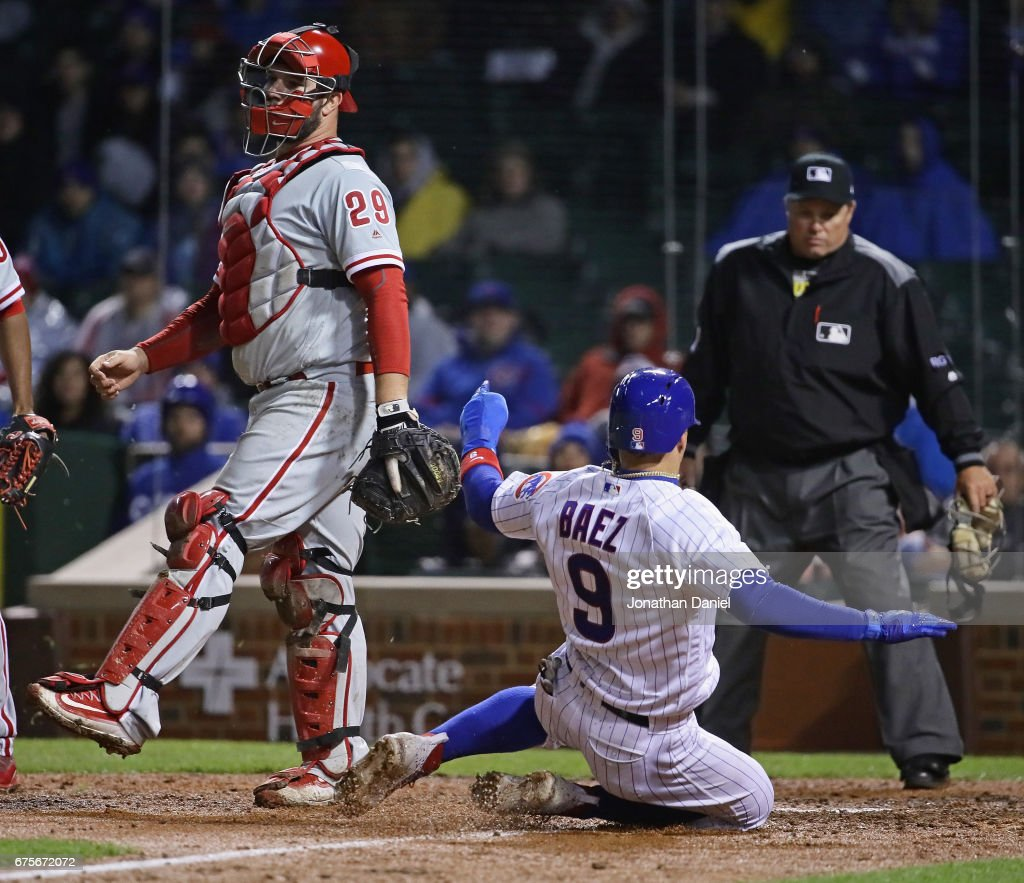 Javier Baez #9 of the Chicago Cubs scores a run in the 7th inning as Cameron Rupp #29 of the Philadelphia Phillies awaits the throw at Wrigley Field on May1, 2017 in Chicago, Illinois.