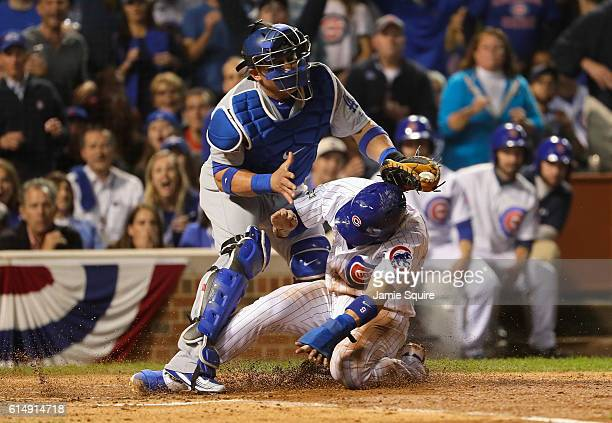 Javier Baez of the Chicago Cubs steals home in the second inning as Carlos Ruiz of the Los Angeles Dodgers is unable to make the tag during game one...