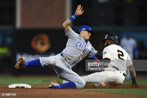 Javier Baez of the Chicago Cubs tags out Denard Span of the San Francisco Giants attempting to steal second base in the third inning of Game Four of...