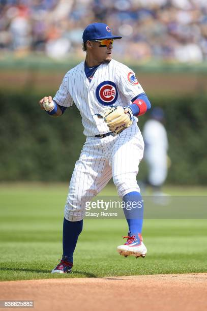 Javier Baez of the Chicago Cubs warms up between innings during a game against the Toronto Blue Jays at Wrigley Field on August 20 2017 in Chicago...
