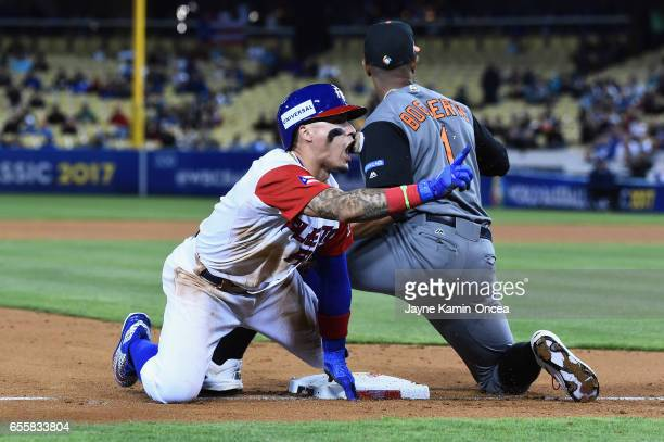 Javier Baez of the Puerto Rico reacts as he beats the tag by Xander Bogaerts of the Netherlands in the during Game 1 of the Championship Round of the...