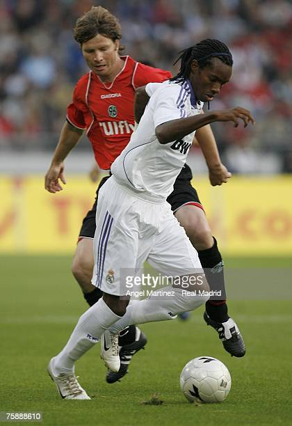 Javier Balboa of Real Madrid controls the ball beside Michael Tarnat of Hanover 96 during the pre season friendly match between Hanover 96 and Real...