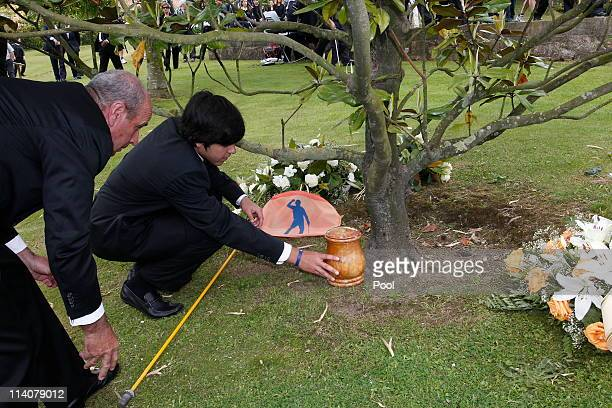 Javier Ballesteros places the urn containing the ashes of Seve Ballesteros under the magnolia tree on the premises of the family estate at the end of...