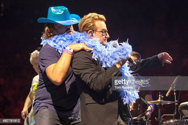 Javier Bardem and Penelope Cruz go on stage whilst U2 perform at Palau Sant Jordi Sala Gaudi on October 10 2015 in Barcelona Spain
