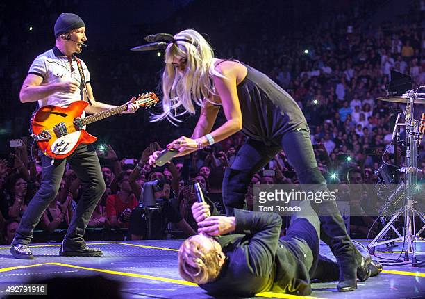 Javier Bardem and Penelope Cruz go on stage whilst U2 perform at Palau Sant Jordi Sala Gaudi on October 10 2015 in Barcelona Spain