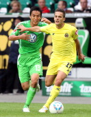 Javier Camunas of Villarreal of Wolfsburg is challenged by Makoto Hasebe of Wolfsburg during the preseason friendly between VfL Wolfsburg and...