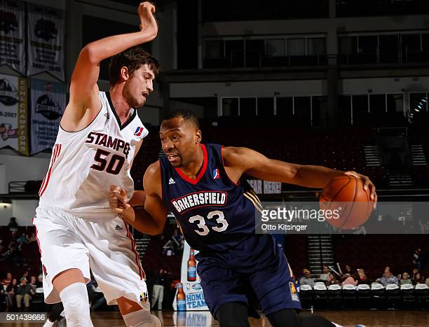 Javier Carter of the Bakersfield Jam drives to the basket against Tibor Pleiss of the Idaho Stampede at CenturyLink Arena on December 12 2015 in...