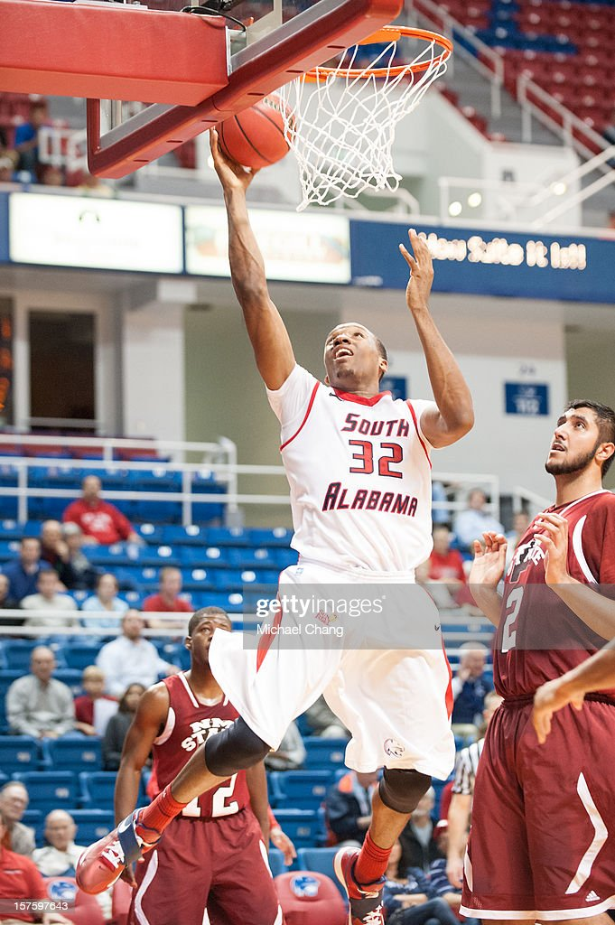 Javier Carter #32 of the South Alabama Jaguars attempts a layup in front of Sim Bhullar #2 of the New Mexico State Aggies at USA Mitchell Center on December 4, 2012 in Mobile, Alabama. At halftime New Mexico State leads South Alabama 31-25.