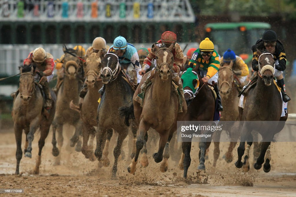 <a gi-track='captionPersonalityLinkClicked' href=/galleries/search?phrase=Javier+Castellano&family=editorial&specificpeople=626179 ng-click='$event.stopPropagation()'>Javier Castellano</a> (center) atop Normandy Invasion leads the field as Joel Rosario atop Orb (far left) races from behind through the fourth turn to victory in the running of the 139th Kentucky Derby at Churchill Downs on May 4, 2013 in Louisville, Kentucky.