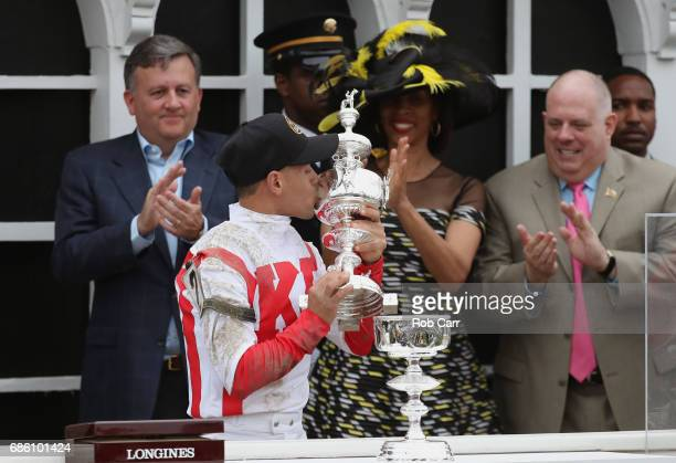 Javier Castellano rider of Cloud Computing celebrates with the trophy alongside Baltimore City Stephanie RawlingsBlake and Maryland Governor Larry...