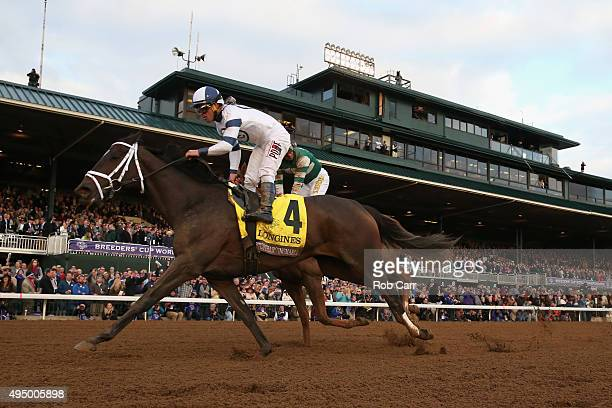Javier Castellano rides Stopchargingmaria to edge out Stellar Wind with by Victor Espinoza up to win the Breeder's Cup Distaff at Keeneland...