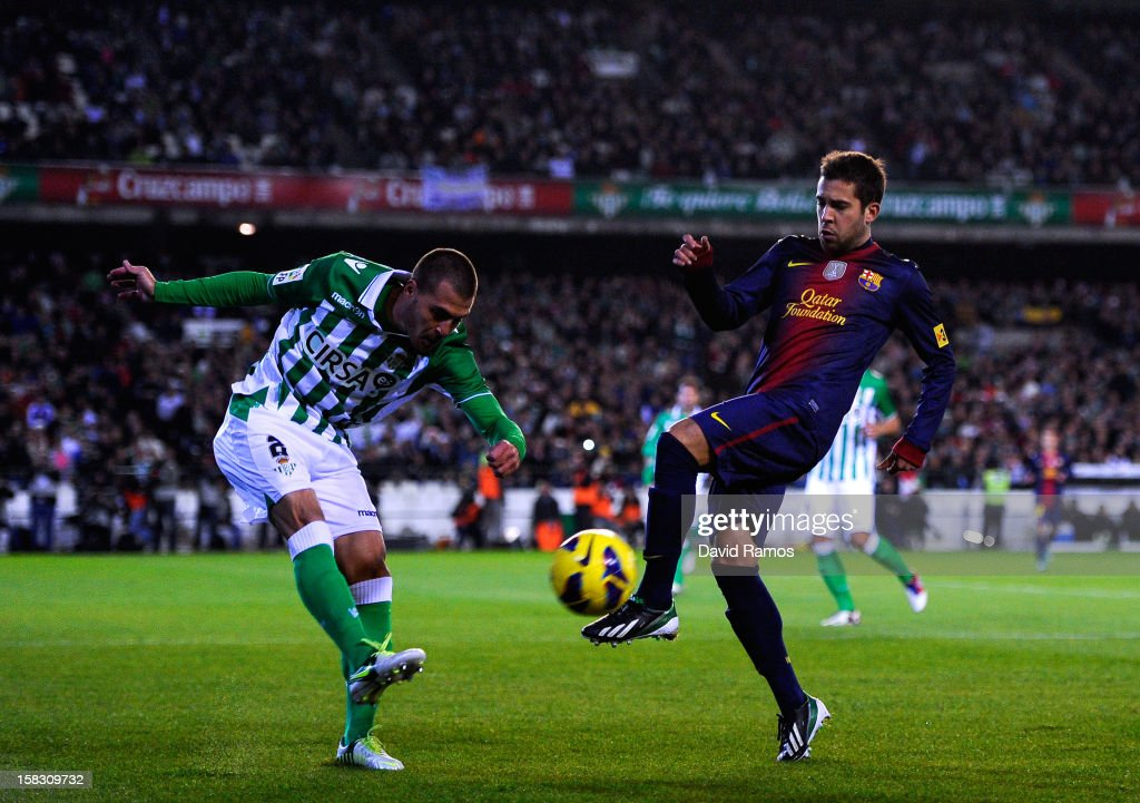 Javier Chica of Real Betis Balompie clear the ball under pressure from <a gi-track='captionPersonalityLinkClicked' href=/galleries/search?phrase=Jordi+Alba&family=editorial&specificpeople=5437949 ng-click='$event.stopPropagation()'>Jordi Alba</a> of FC Barcelona during the La Liga match between Real Betis Balompie and FC Barcelona at Estadio Benito Villamarin on December 9, 2012 in Seville, Spain.