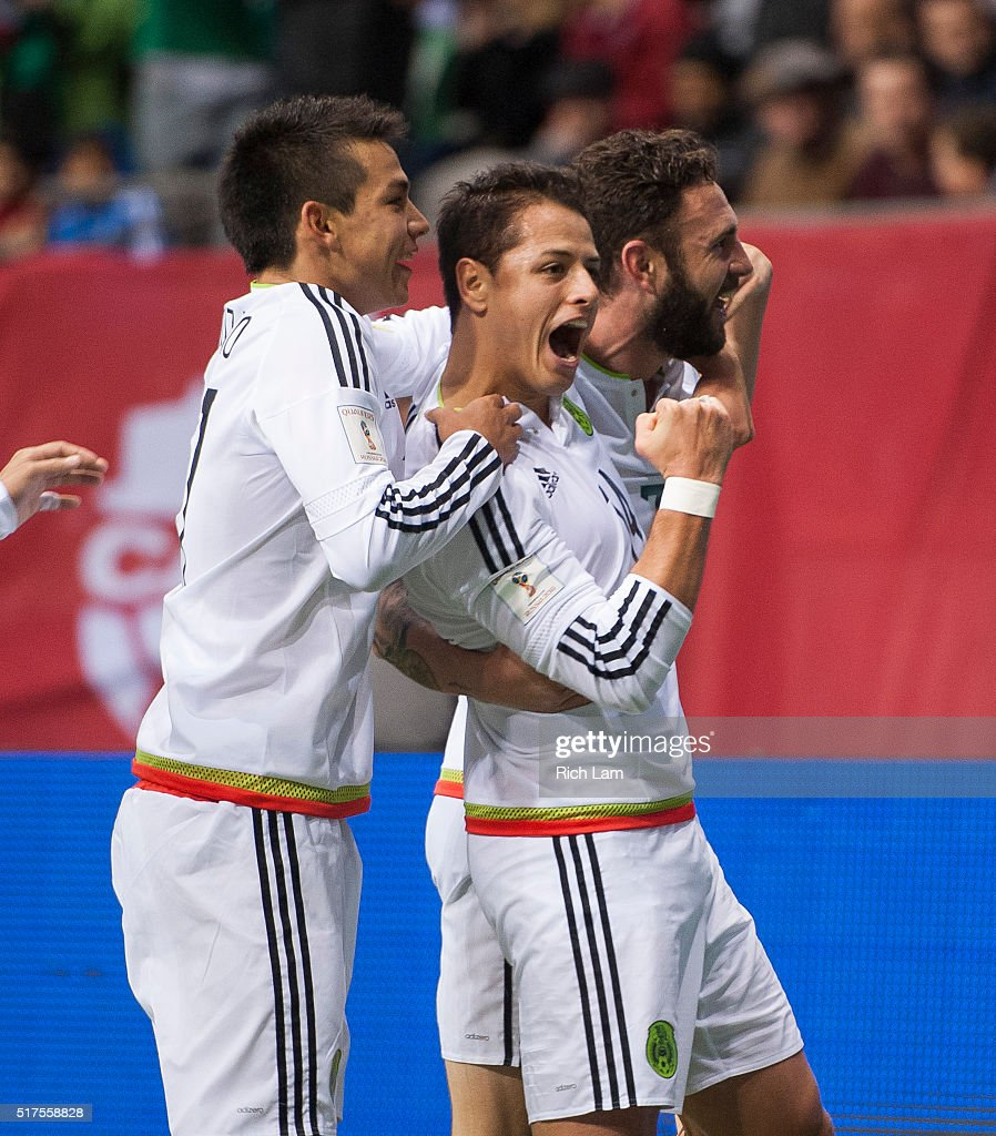Javier 'Chicharito' Herhandez #14 of Mexico is congratulated by teammates <a gi-track='captionPersonalityLinkClicked' href=/galleries/search?phrase=Javier+Aquino&family=editorial&specificpeople=7218711 ng-click='$event.stopPropagation()'>Javier Aquino</a> #11 and Miguel Layun #7 of Mexico after scoring a goal against Canda during FIFA 2018 World Cup Qualifier soccer action at BC Place on March 25, 2016 in Vancouver, Canada.