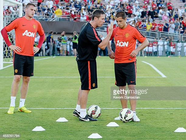 Javier ''Chicharito''' Hernandez and Sam Johnstone of Manchester United listen to a training coach warms up during the preseason friendly match...