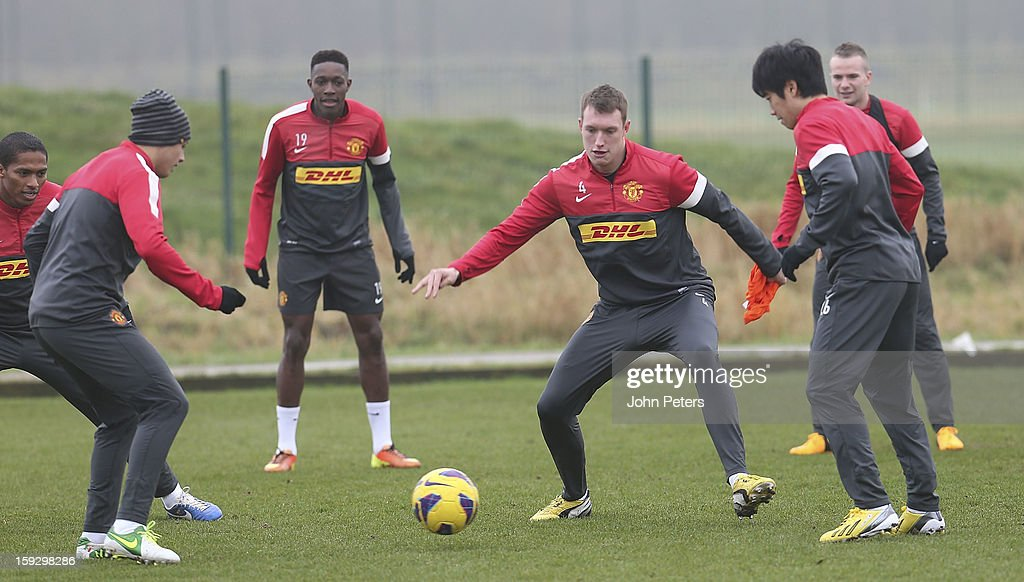 Javier 'Chicharito' Hernandez, Danny Welbeck, Phil Jones and Shinji Kagawa of Manchester United in action during a first team training session at Carrington Training Ground on January 11, 2013 in Manchester, England.