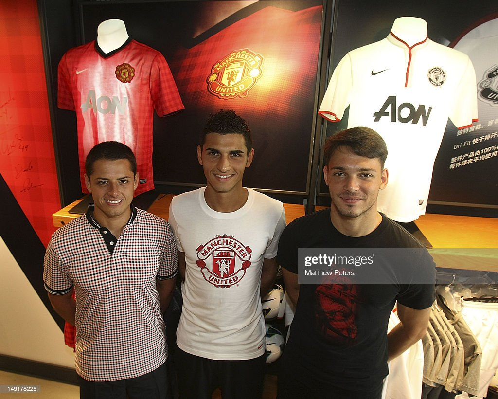 Javier 'Chicharito' Hernandez, Davide Petrucci and Frederic Veseli of Manchester United attends the launch of a new Manchester United Fitness app in association with Nike on July 24, 2012 in Shanghai, China.