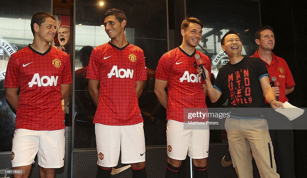 Javier 'Chicharito' Hernandez, Davide Petrucci and Frederic Veseli of Manchester United attend the launch of a new Manchester United Fitness app in association with Nike on July 24, 2012 in Shanghai, China.