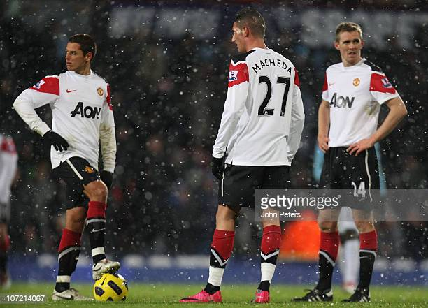 Javier 'Chicharito' Hernandez Federico Macheda and Darren Fletcher of Manchester United show their disappointment during the Carling Cup quarterfinal...