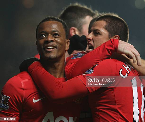 Javier 'Chicharito' Hernandez of Manchester United celebrates scoring their third goal during the Barclays Premier League match between Chelsea and...
