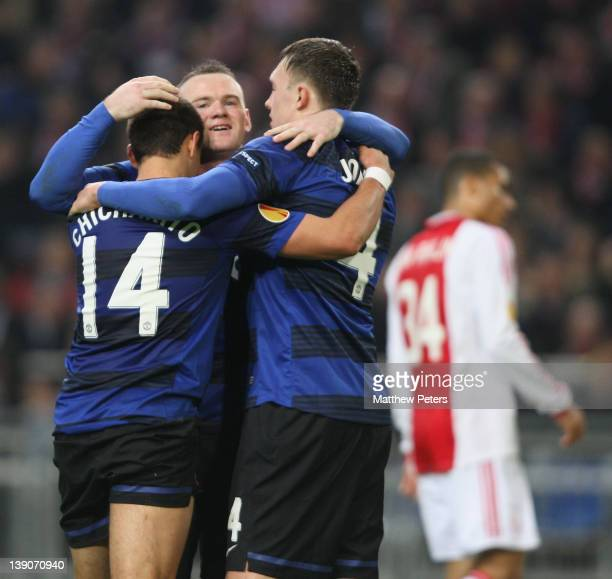 Javier 'Chicharito' Hernandez of Manchester United celebrates scoring their second goal during the UEFA Europa League round of 32 first leg match...
