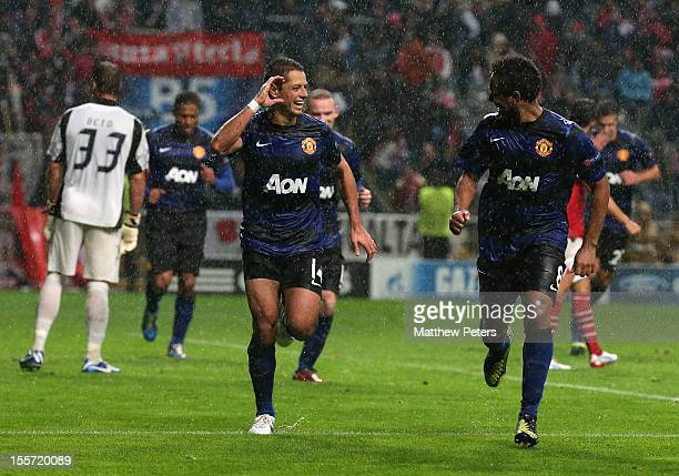 Javier 'Chicharito' Hernandez of Manchester United celebrates scoring their third goal during the UEFA Champions League Group H match between SC...