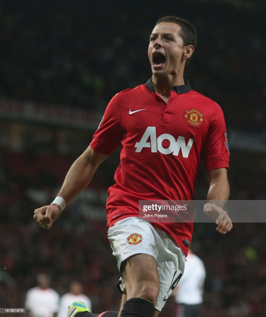 Javier 'Chicharito' Hernandez of Manchester United celebrates scoring their first goal during the Capital Cup Third Round match between Manchester United and Liverpool at Old Trafford on September 25, 2013 in Manchester, England.