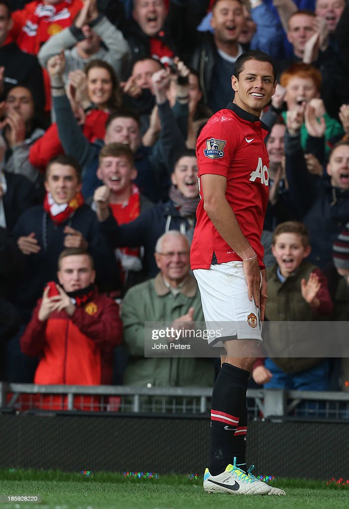 Javier 'Chicharito' Hernandez of Manchester United celebrates scoring their third goal during the Barclays Premier League match between Manchester United and Stoke City at Old Trafford on October 26, 2013 in Manchester, England.