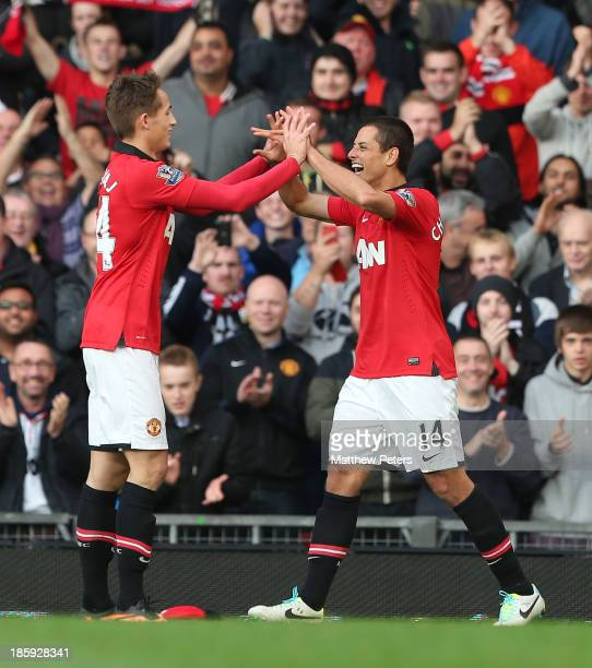 Javier 'Chicharito' Hernandez of Manchester United celebrates scoring their third goal during the Barclays Premier League match between Manchester...