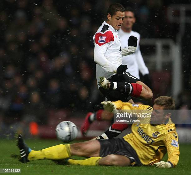Javier 'Chicharito' Hernandez of Manchester United clashes with Rob Green of West Ham United during the Carling Cup quarterfinal match between West...