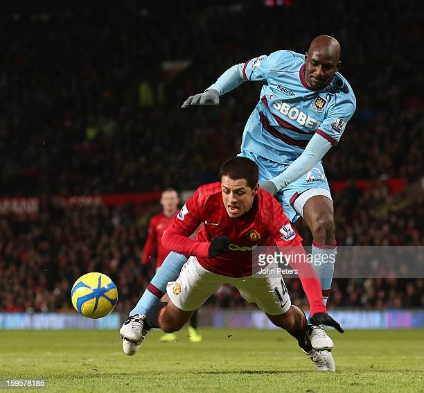 Javier 'Chicharito' Hernandez of Manchester United in action with Alou Diarra of West Ham United during the FA Cup Third Round Replay match between...