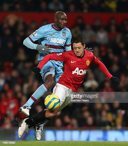 Javier 'Chicharito' Hernandez of Manchester United in action with Alou Diarra of West Ham United during the FA Cup Third Round Replay between...