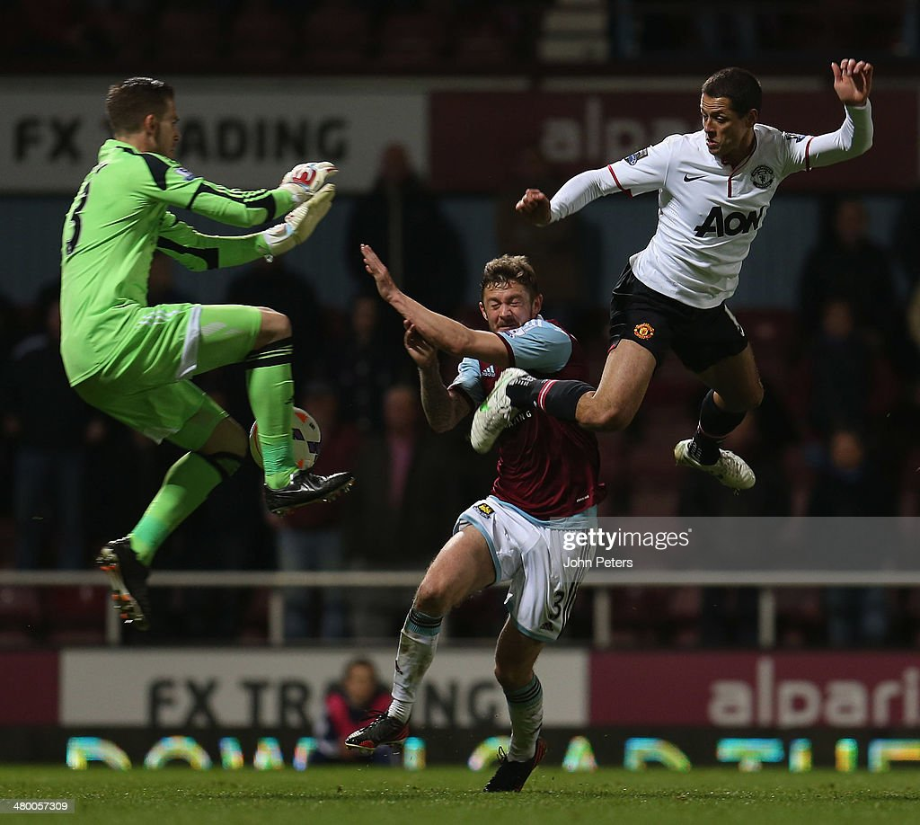 Javier 'Chicharito' Hernandez of Manchester United in action with Adrian and George McCartney of West Ham United during the Barclays Premier League match between West Ham United and Manchester United at Boleyn Ground on March 22, 2014 in London, England.