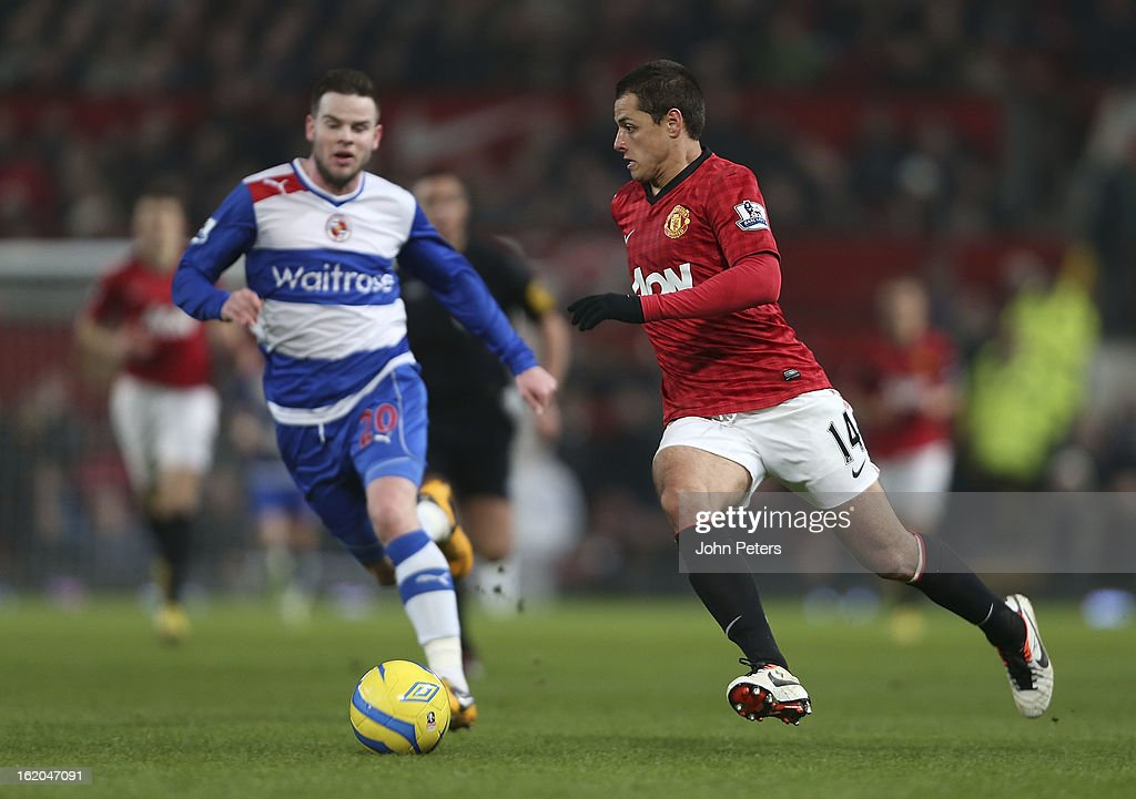 Javier 'Chicharito' Hernandez of Manchester United in action with Danny Guthrie of Reading during the FA Cup Fifth Round match between Manchester United and Reading at Old Trafford on February 18, 2013 in Manchester, England.
