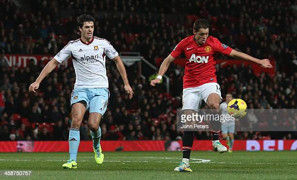 Javier 'Chicharito' Hernandez of Manchester United in action with James Tomkins of West Ham United during the Barclays Premier League match between...