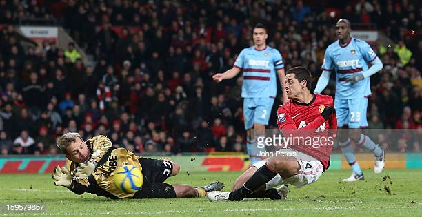 Javier 'Chicharito' Hernandez of Manchester United in action with Jussi Jaaskelainen of West Ham United during the FA Cup Third Round Replay match...