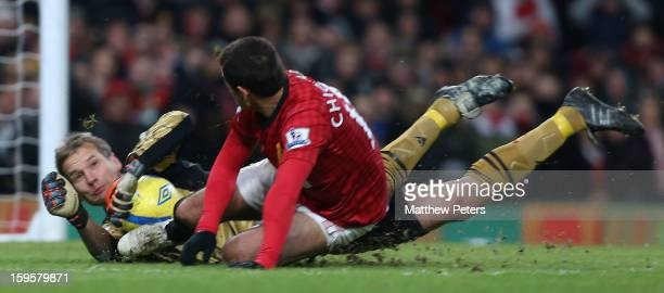 Javier 'Chicharito' Hernandez of Manchester United in action with Jussi Jaakelainen of West Ham United during the FA Cup Third Round Replay between...