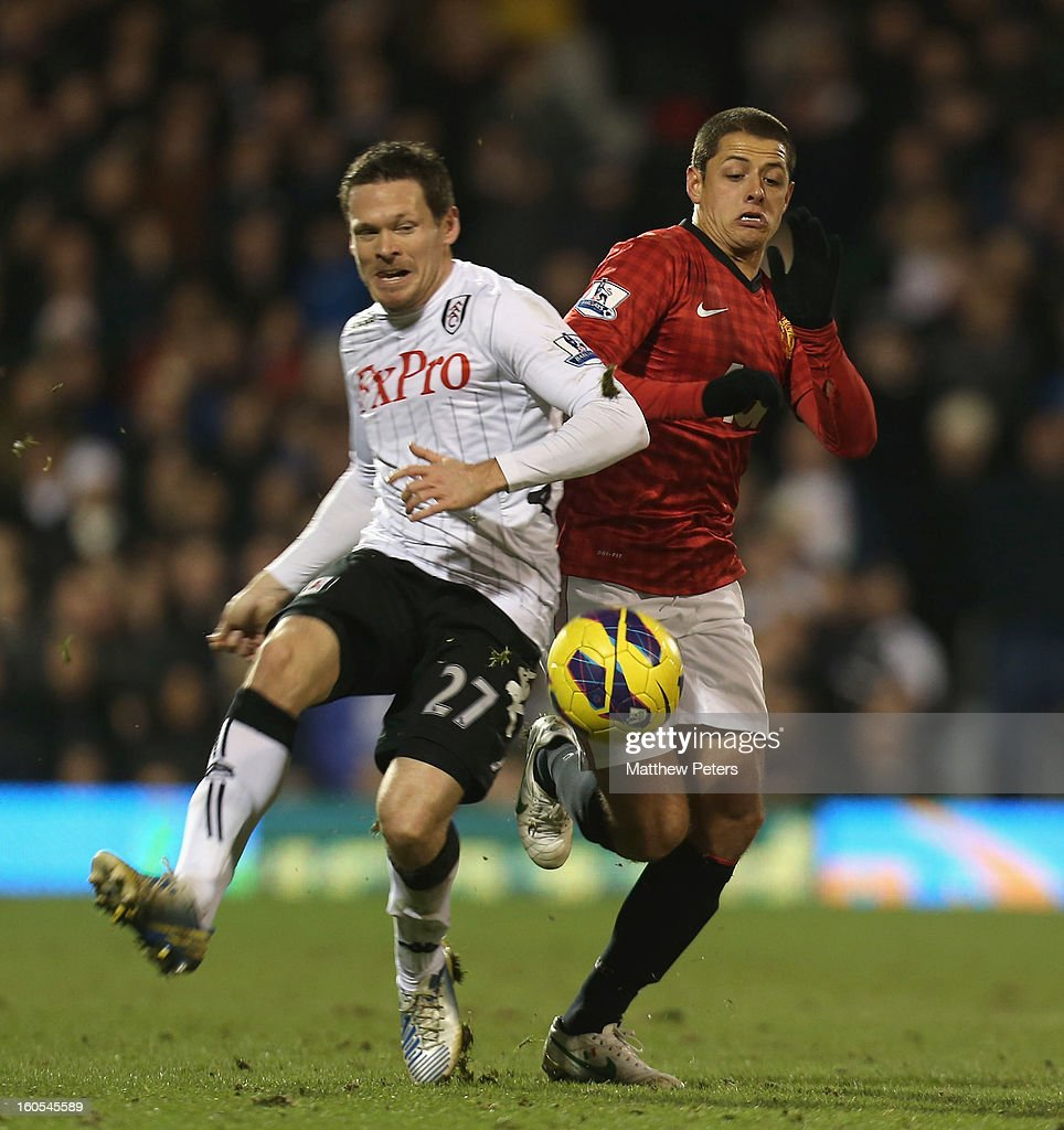 Javier 'Chicharito' Hernandez of Manchester United in action with <a gi-track='captionPersonalityLinkClicked' href=/galleries/search?phrase=Sascha+Riether&family=editorial&specificpeople=614139 ng-click='$event.stopPropagation()'>Sascha Riether</a> of Fulham during the Barclays Premier League match between Fulham and Manchester United at Craven Cottage on February 2, 2013 in London, England.